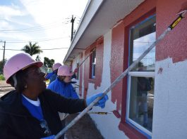 Habitat for Humanity of Martin County volunteers painting a home.