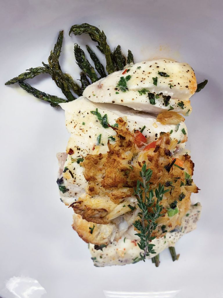 Meating Street Crabmeat-encrusted black grouper finished in a citrus beurre blanc