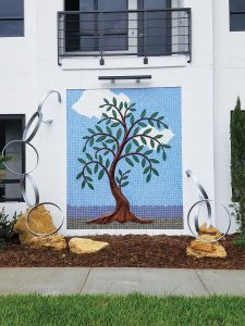 New Life, mosaic with aluminum coated ring sculpture in West Palm Beach. Photo by Lucy Keshavarz