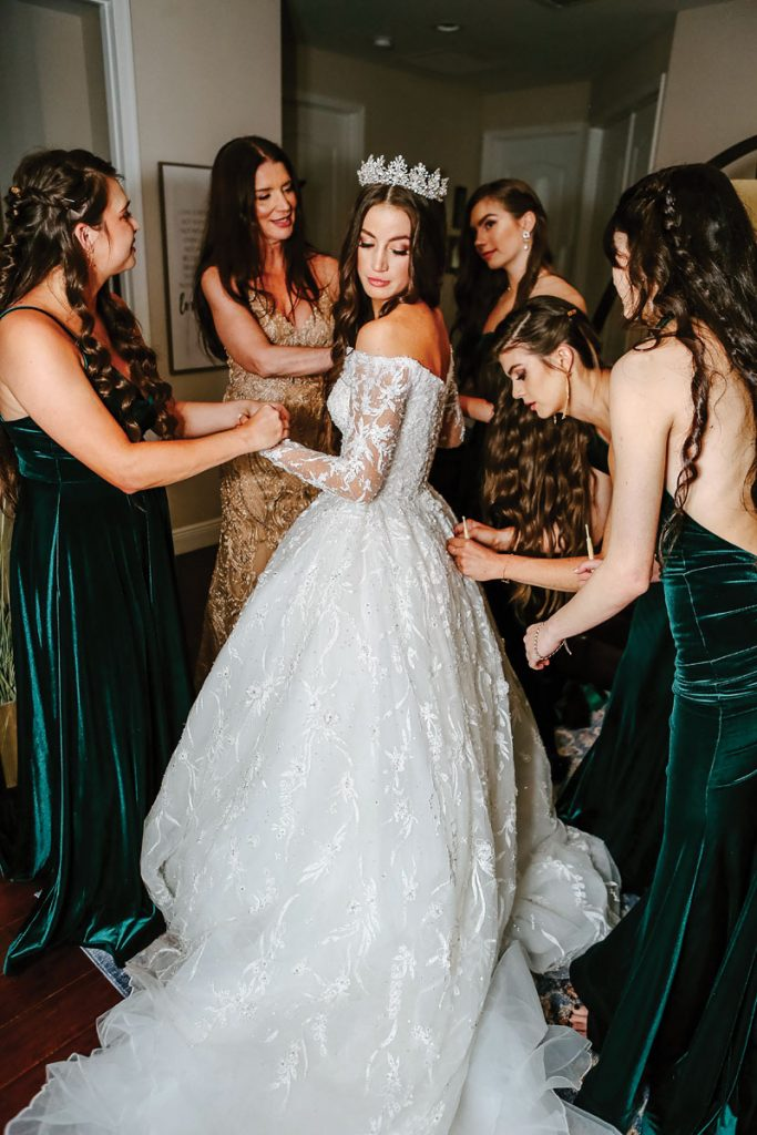 Gabriella shined in a Madeline Gardner gown and a crystal hairpiece by Paisley Designs, Gabriella and Trevor Deggeller wedding, Photo by Jennifer Sampson