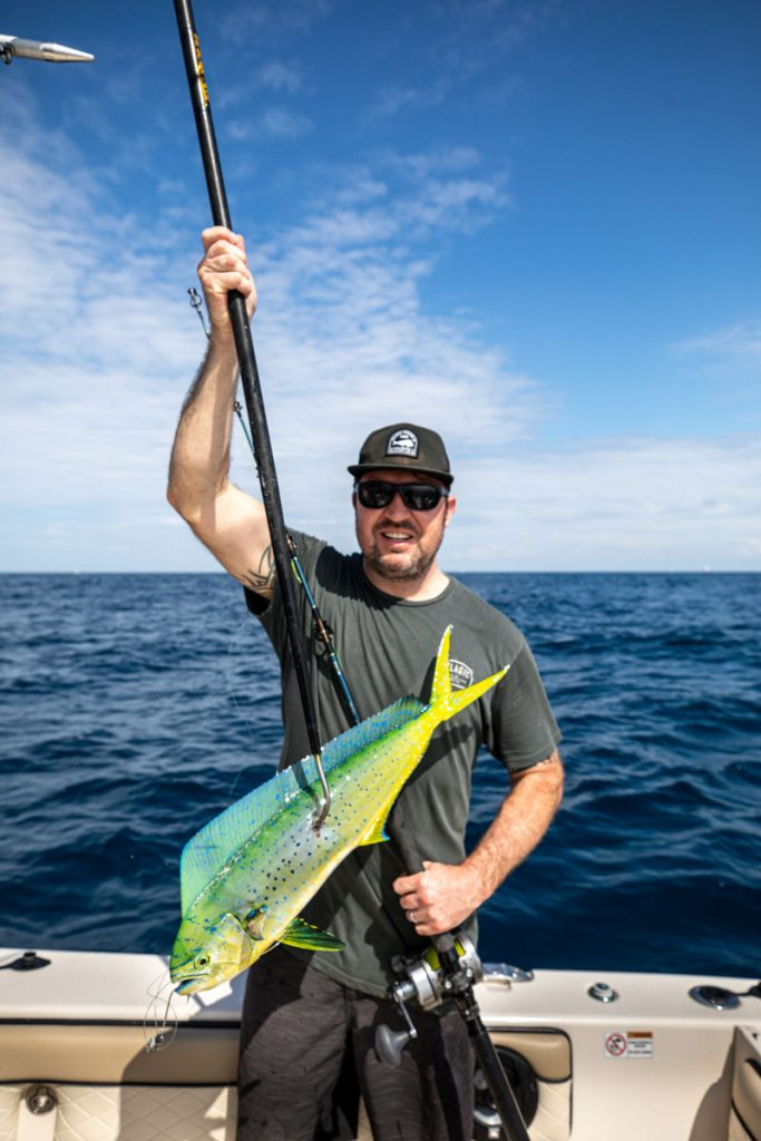 SeatoPlateAdventure_StuartMag_TimNickey_1410Photo by Benjamin Rusnak prized catch of the day: a 22-inch mahi-mahi, which he'll use to prepare a meal for his family.
