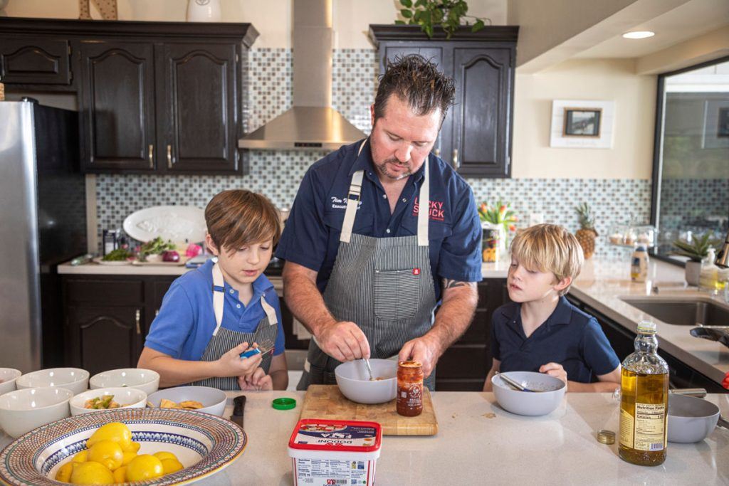 Nickey's sons Christian and Michael help out in the kitchen.