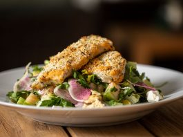Garlic and herb–crusted local mahi-mahi and Middle Eastern fattoush salad