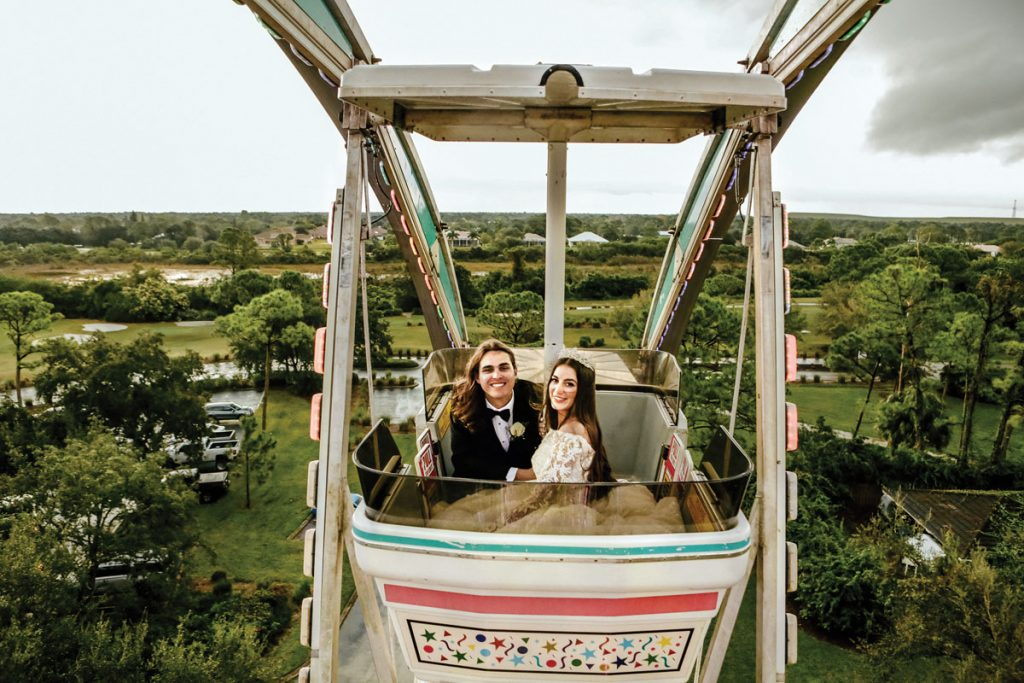 The happy couple takes a spin on the Ferris wheel, Gabriella and Trevor Deggeller wedding.<br/> Photography by Jennifer Sampson
