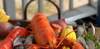 Clambakes come in all shapes and sizes, but adding ingredients like lobster, corn, potatoes, and sausage is delish!
