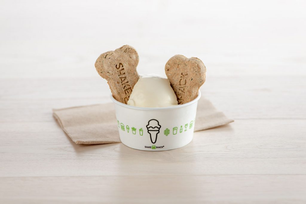 """Treat your best pal to dog biscuits and a vanilla """"Pooch-ini"""" at Shake Shack, photo courtesy of Shake Shack"""
