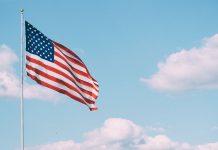 American Flag, photo by Aaron Burden via Unsplash