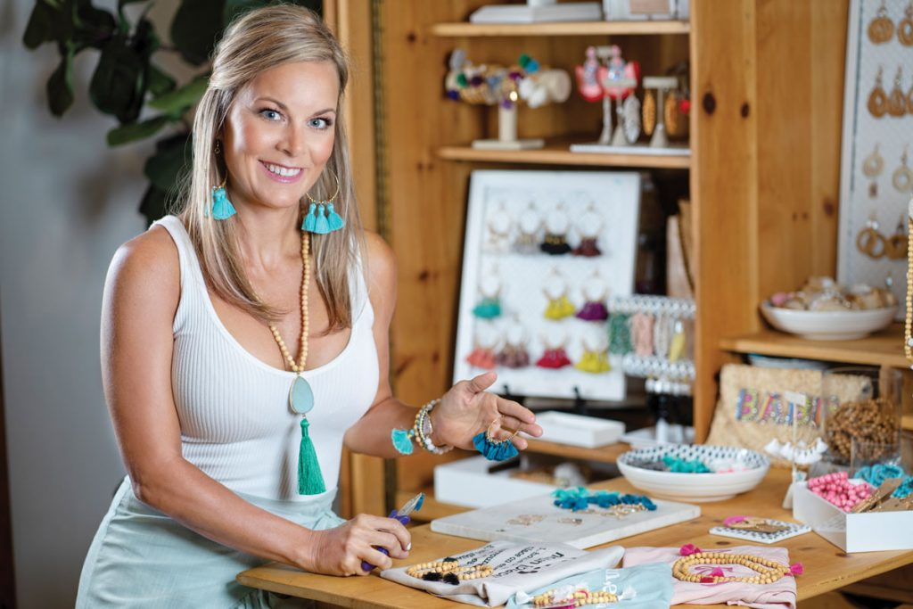 Ashley Belford crafting jewelry in her Jupiter home, photo by Steven Martine