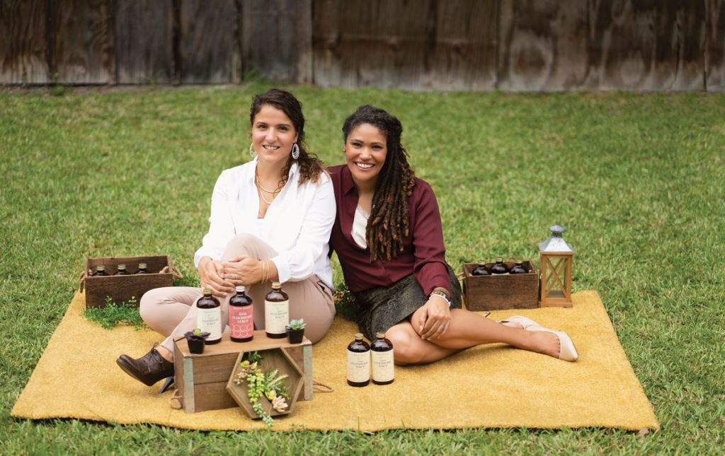 Brittney Hurt (left) and Ashley Lancelot with some of their syrup products in Fort Pierce, photo by Steven Martine